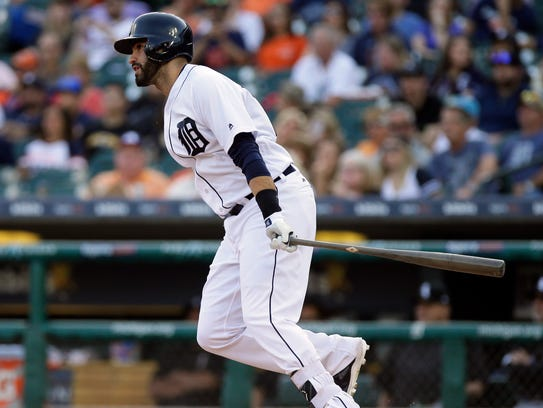 Tigers rightfielder J.D. Martinez hits an RBI-double