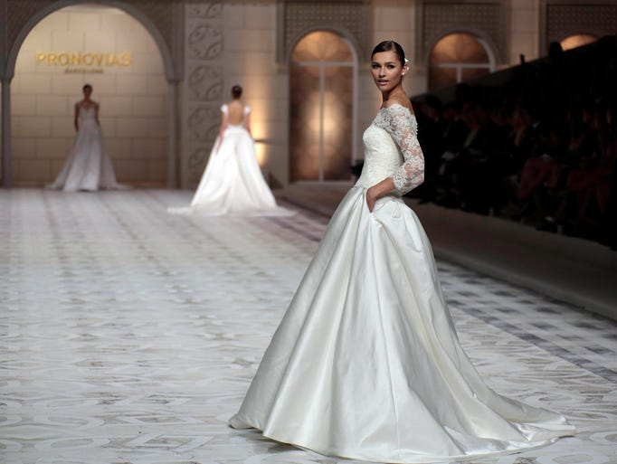 BARCELONA, SPAIN - MAY 09:  A model walks the runway during Pronovia's 50th anniversary bridal fashion show during 'Barcelona Bridal Week 2014'  on May 9, 2014 in Barcelona, Spain.  (Photo by Miquel Benitez/Getty Images)