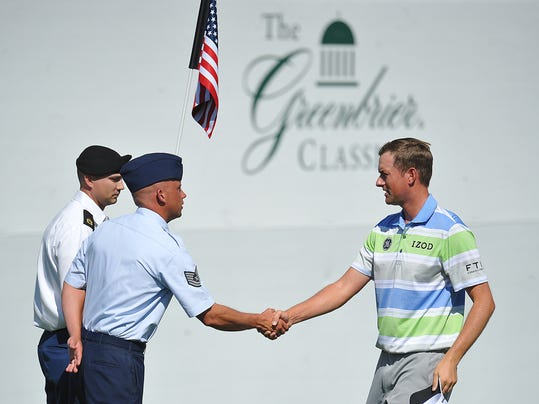 Golfer Webb Simpson, right, shakes hands with West Virginia Air National Guard TSGT Kevin Cordel during the second round of the Greenbrier Classic golf tournament at the Greenbrier Resort in White Sulphur Springs, W.Va., Friday, July 4, 2014  (AP Photo/Chris Tilley)