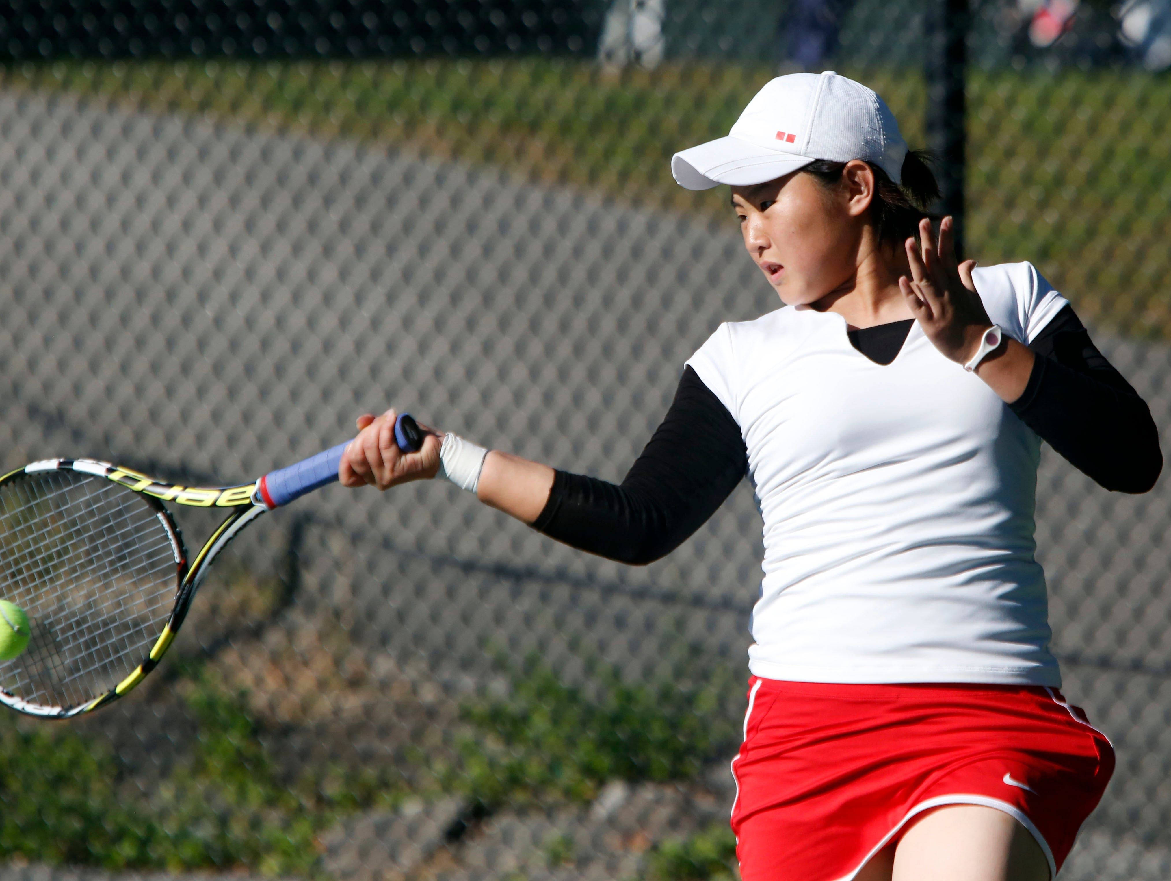 Mayu Tezuka of Keio returns the ball to Pleasantville's Olivia Ashton in the Conference III tennis tournament Oct. 15, 2015 at Edgemont High School in Scarsdale.