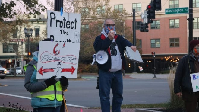 A group of around 30 people gathered in Salem's Riley Plaza Wednesday evening to demand that every vote be counted in the 2020 general election.