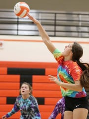 Katelyn Gray spikes the ball during practice on Friday, Sept. 16, 2016, at Scio High School.