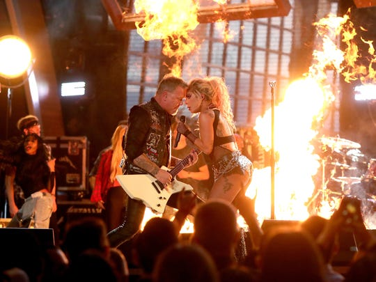 James Hetfield of Metallica (left) and Lady Gaga perform at the Grammy Awards on February 12, 2017, in Los Angeles.