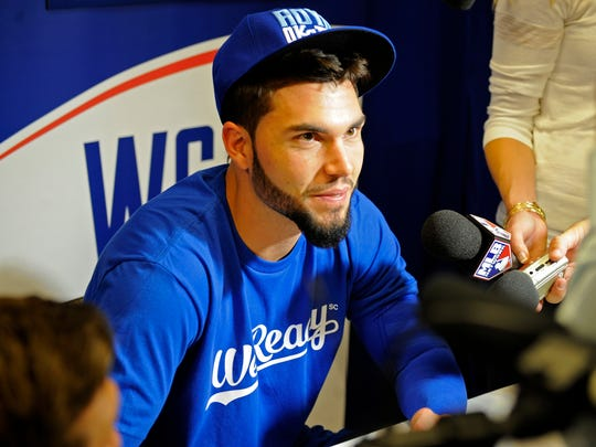 Oct 20, 2014; Kansas City, MO, USA; Kansas City Royals first baseman Eric Hosmer (35) talks with members of the media during practice the day before the start of the 2014 World Series at Kauffman Stadium. Mandatory Credit: Christopher Hanewinckel-USA TODAY Sports
