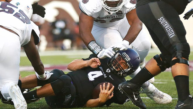 Southwestern (Kan.) College quarterback Christian Gordon (4) had a long night against Cecil Bratton and the rest of the Missouri State defense in the opener.