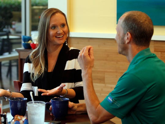 Cassie Puhl and Sam Moreland discuss their love of the water at Poached in Bonita Springs.