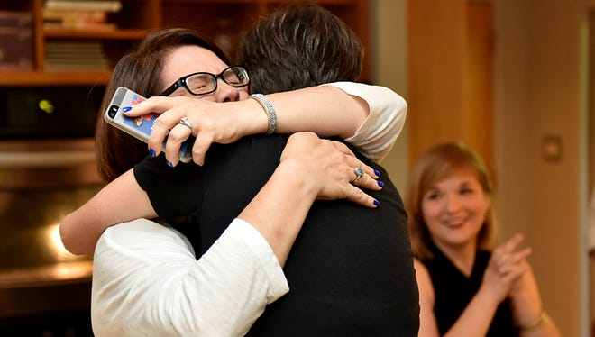 Carla Webb (left) and partner Jocelyn Pritchett hug before the gay marriage ruling by the Supreme Court during a gathering Friday at Pritchett's home in Jackson.