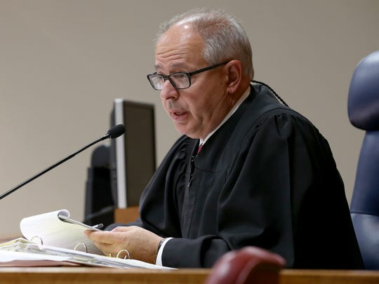 Monroe County Court Judge James Piampiano speaks to the jury after the opening remarks in the Charles Tan case.