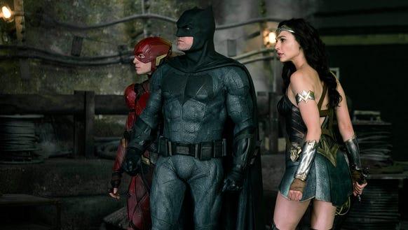 The Flash (far left, Ezra Miller) joins superheroes