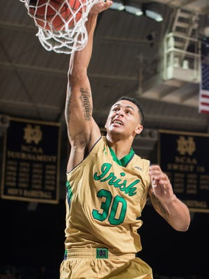 Notre Dame Fighting Irish forward Zach Auguste (30) dunks in the first half against the Florida State Seminoles at the Purcell Pavilion.