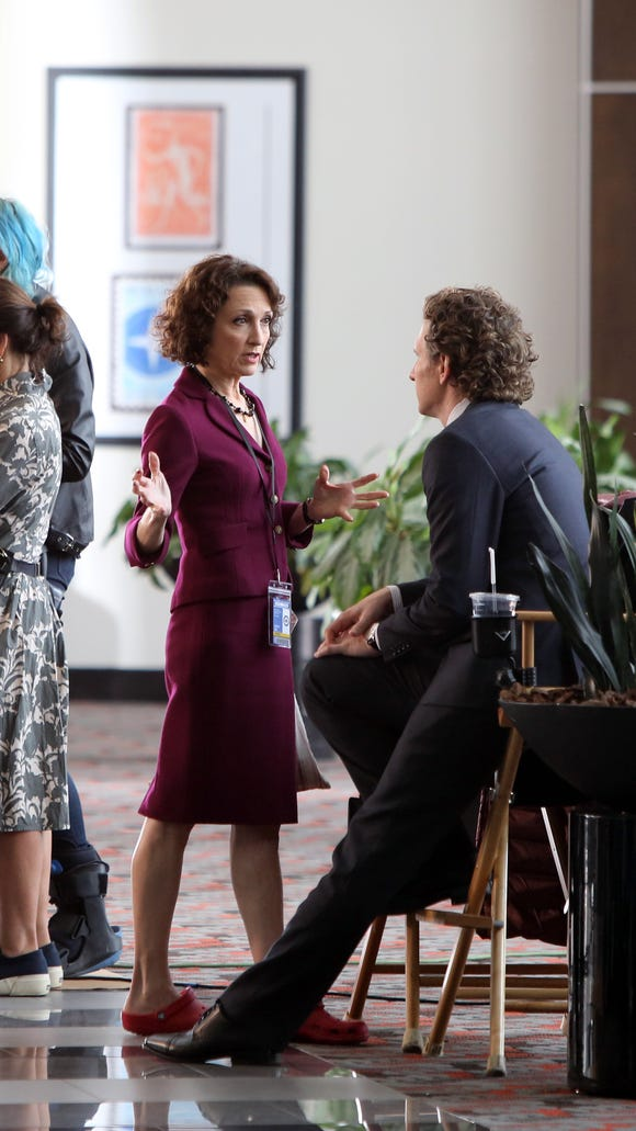 "Actors Bebe Neuwirth and Sebastian Arcelus chat during a break in filming CBS's ""Madam Secretary"" at 1133 Westchester Ave. in White Plains on April 17."