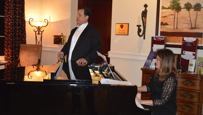 "Tenor Cesar Sanchez performs a song during the ""Meet the Puccini Artists"" reception, accompanied on piano by Julie Tompkins."