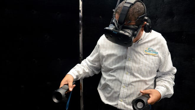 Eddie Hernandez, a finance manager at Nissan of Visalia tries out the Star Wars: Droid Repair Bay Virtual Reality experience.