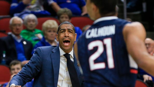 Connecticut coach Kevin Ollie shouts instructions during