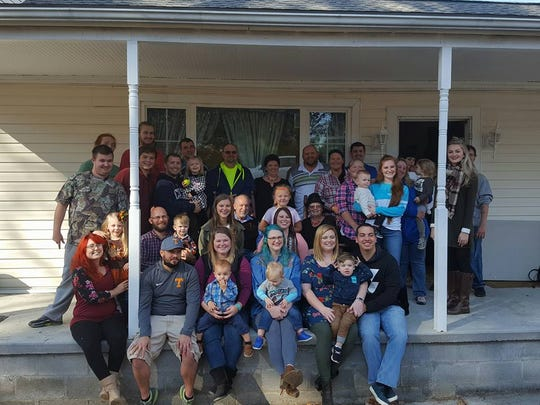 Paul Moyers, third from left on the second row, shares a large family Thanksgiving with his children and grandchildren, siblings and their families.
