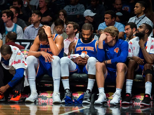 New York Knicks' players react during the second half of a preseason NBA basketball game against Brooklyn Nets, Sunday, Oct. 8, 2017, in New York. (AP Photo/Andres Kudacki)