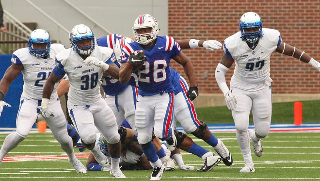 Louisiana Tech running back Kenneth Dixon (28) returned from injury Saturday and was the reason why the Bulldogs had the upper hand in the run game.