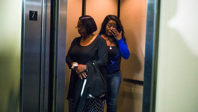 January 31, 2017 - Vivian Woods (left), mother of slain Memphis police officer Martoiya Lang, catches a lift with an unidentified family member after Trevano Campbell was found guilty of second-degree murder Tuesday in the 2012 killing of Lang. Lang, 32, a mother of four, was the first woman killed in the line of duty in the history of the Memphis Police Department.