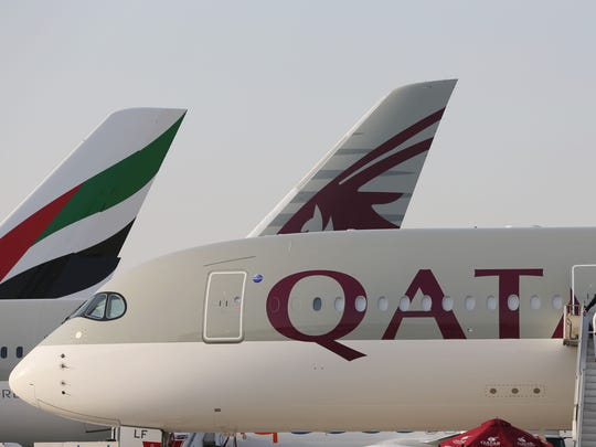 The tail of an Emirates airline plane can be seen to