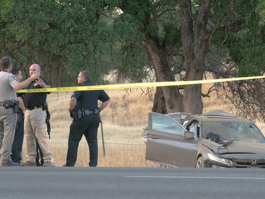 Officers investigate Saturday an officer-involved shooting in Los Molinos. The suspect, who has been identified as a Stockton man, fled in a Honda Accord that crashed on Interstate 5 north of Red Bluff.