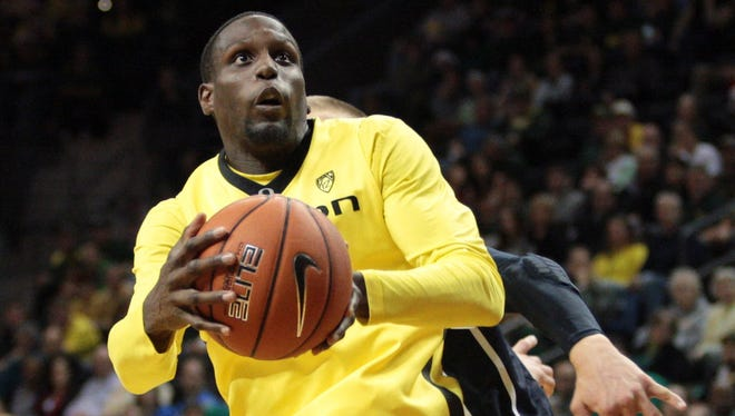 Oregon Ducks guard Jason Calliste shoots the ball against Brigham Young Cougars at Matthew Knight Arena.