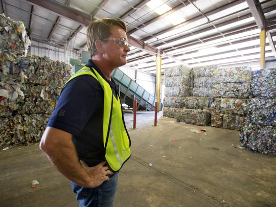 Michael Kean, general manager of United Fibers, a recycling operation in Chandler, stands in a warehouse of bundle recyclable materials on July 30, 2015.
