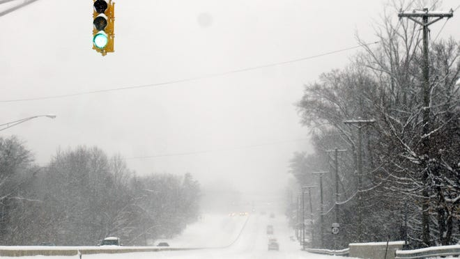 A December 2013 storm produced near-whiteout conditions on Route 38 in Moorestown. South Jersey could see similar conditions as a storm promising 14 to 24 inches of snow plus high winds heads our way.