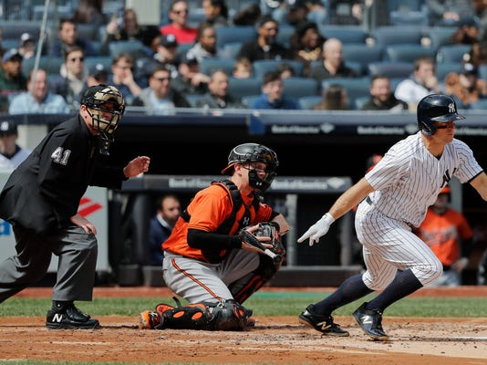New York Yankees' Brett Gardner, right, follows through with a two-run base hit during the second inning of a baseball game against the Baltimore Orioles, Saturday, April 7, 2018, in New York. (AP Photo/Julie Jacobson)