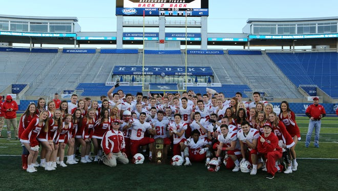 The Beechwood Tigers pose with the championship trophy after the KHSAA Class A title game at Kroger Field at the University of Kentucky in Lexington. Beechwood defeated Raceland 41-0 to claim back-to-back Championships.