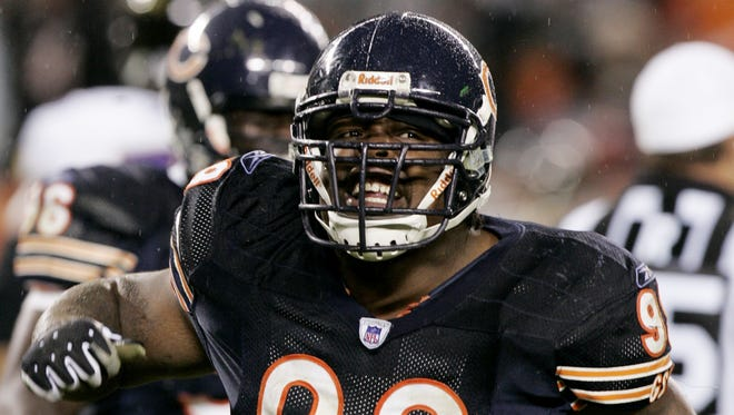 """Former Chicago Bears defensive tackle Terry """"Tank"""" Johnson celebrates after his fourth-quarter sack of Baltimore Ravens quarterback Anthony Wright during the Bears' 10-6 win Sunday, Oct. 23, 2005, in Chicago."""