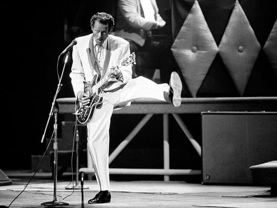 Chuck Berry performs during a concert celebration for his 60th birthday at the Fox Theatre in St. Louis on Oct. 17, 1986.