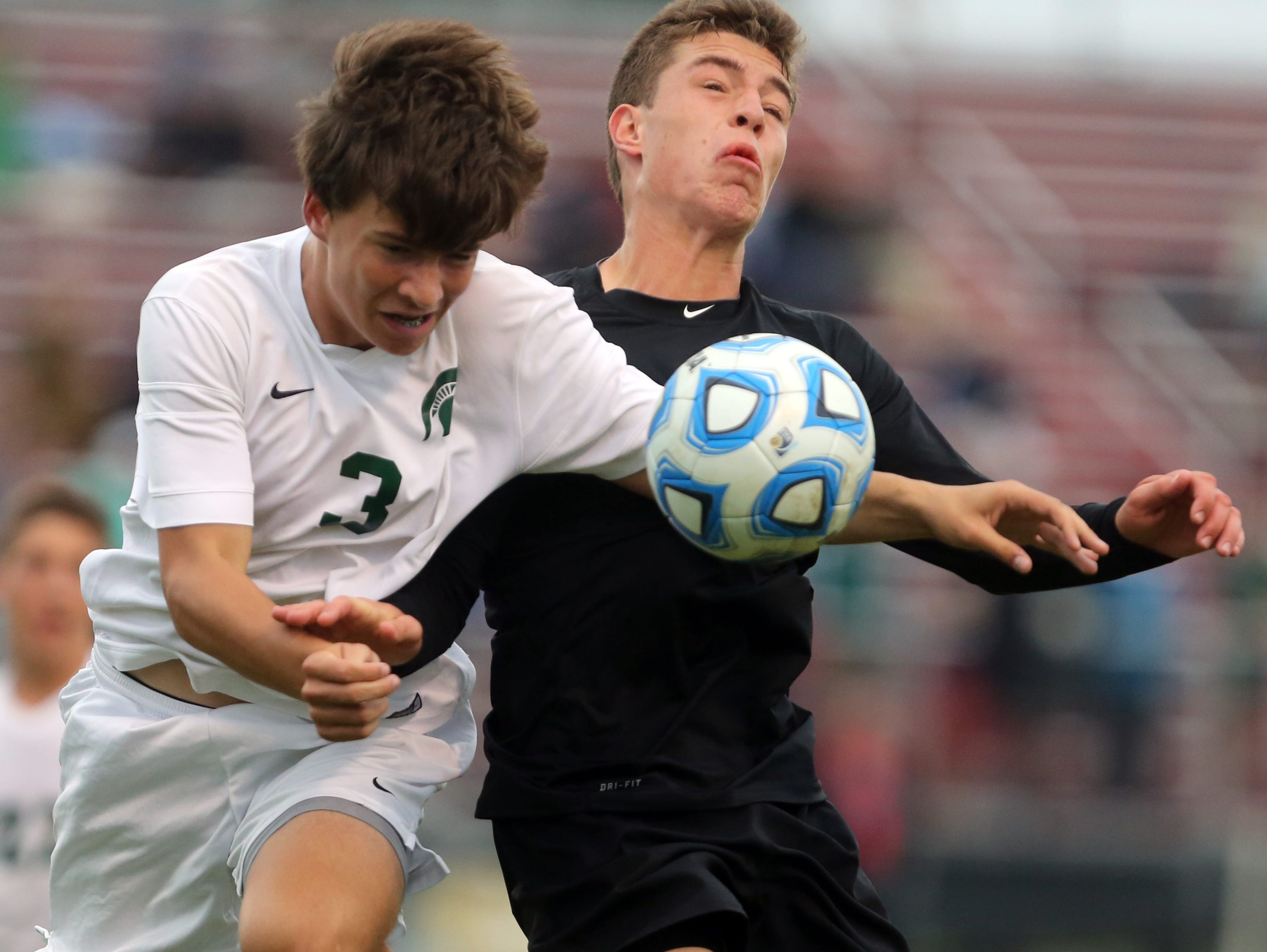 Battle Ground Academy's Jack Arnold fights for control of the ball with Webb School's Guthrie Bouchard-Dean during their Division II Class A soccer state final game.