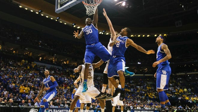 Kentucky's Julius Randle goes for two of his 13 points as the Wildcats advanced to the Sweet 16 against Louisville. Randle also had a game high 10 rebounds against Wichita State. March 23, 2014