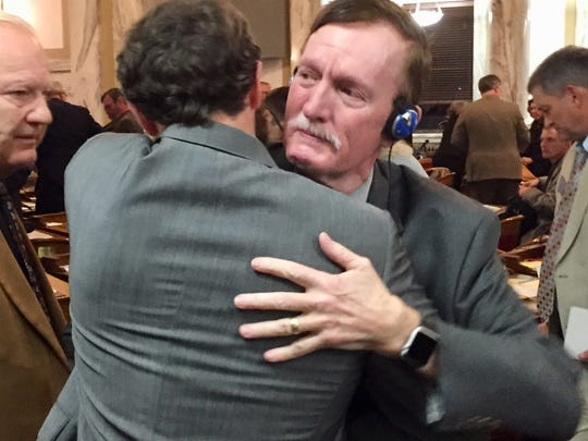 Rep. Kelly Flynn, R-Townsend, right, gets a hug early Thursday after the special session adjourned.