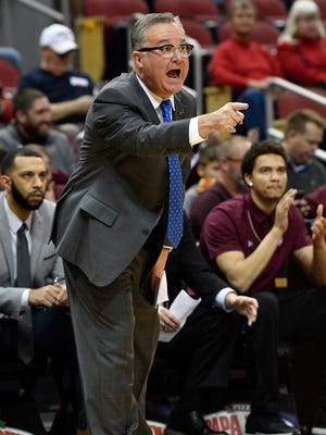 Nov 21, 2017; Louisville, KY, USA; Southern Illinois Salukis head coach Barry Hinson calls out instructions during the first half against the Louisville Cardinals at KFC Yum! Center.