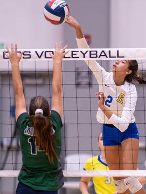 Exeter's Corinne Acosta hits over El Diamante's Alyssa Stevens in a Central Section Division II first-round playoff game in the Porter Field House at College of the Sequoias on Saturday, November 3, 2018.