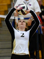 T.L. Hanna senior Gabrielle Easton sets playing Hillcrest during the first set of the Class AAAAA playoff at T.L. Hanna High School in Anderson on Tuesday.