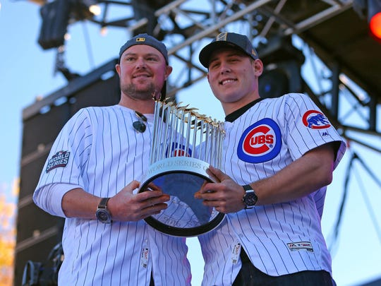 Chicago Cubs starting pitcher Jon Lester (left) and