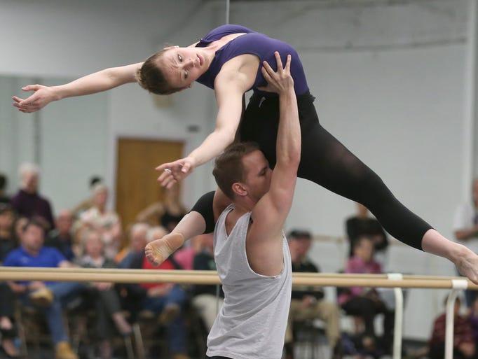 Rochester City Ballet dancer Megan Kamler is held aloft