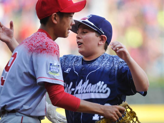 Red Land's Ethan Phillips hugs Japan's Yuma Watanabe after Japan won the Little League World Series Championship in Williamsport Aug. 30, 2015. Japan beat Red Land 18-11.