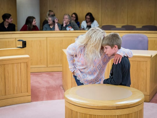 Dawn Rench chats with Patrick before their adoption ceremony at the Justice Center Friday afternoon.