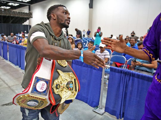 Golden Gloves national champion Frank Martin shows his champion belts during the Indiana Black Expo Midwest Invitational Boxing Showcase, July 17, 2016, at the Indiana Convention Center.