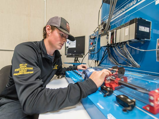 Gull Lake junior Tristan Lemon works with a programmable logic controller (P.L.C.) at the Regional Manufacturing Technology Center on Thursday, Oct. 12, 2017.