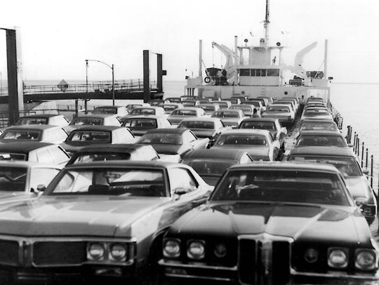 New automobiles fill the top deck of M/V HIGHWAY 16, formerly the USS LST 393, circa 1970.