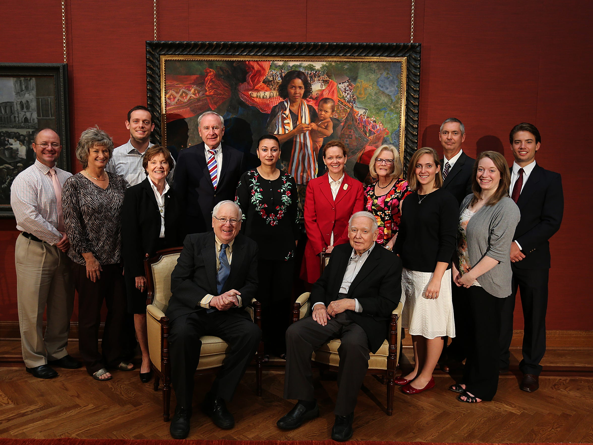 Former Iowa Gov. Robert Ray (seated, right) was honored
