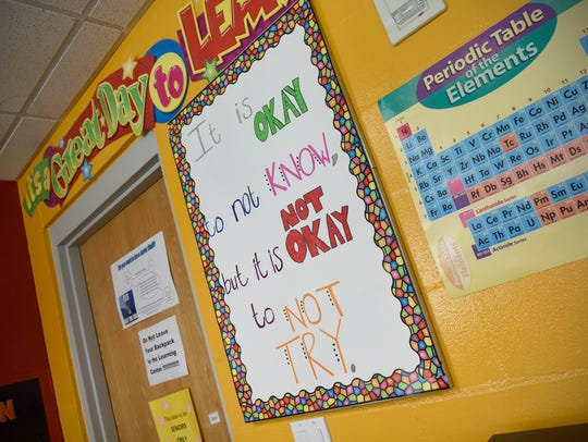 A motto hangs on the wall of the learning center Friday, July 13, at the Southside Boys and Girls Club in St. Cloud.