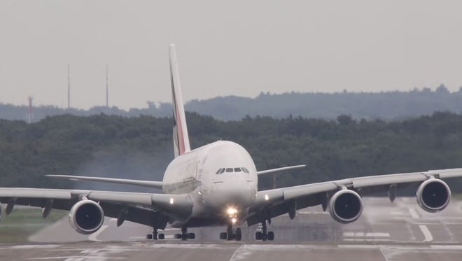 A screengrab of YouTube from a video of an Airbus A380 landing in strong crosswinds in Germany.