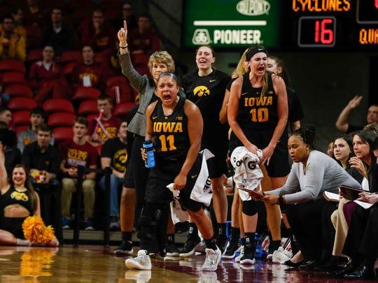 Iowa women's basketball coach Lisa Bluder and the Hawkeye