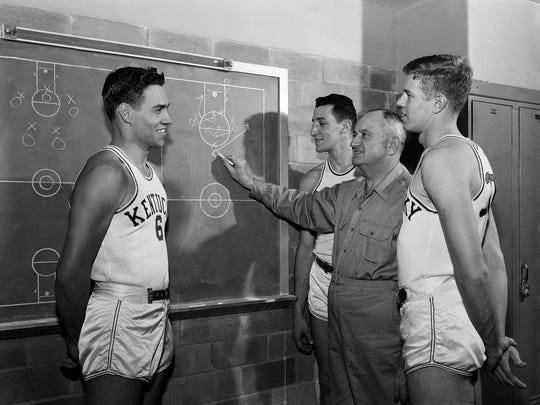 Here Coach Adolph Rupp talks to his five starters, Jan 14, 1954 in Lexington, KY., L to R, Billy Evans, Cliff Hagan, Rupp, Phil Grawemeyer, Frank Ramsey and Lou Tsioropoulos. (AP Photo/John Wyatt)