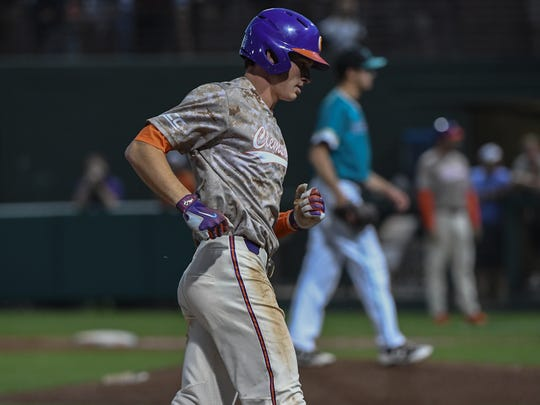 Clemson sophomore shortstop Logan Davidson (8) rounds third base after he hit a home run against Coastal Carolina into the left field Champman grandstands during the bottom of the sixth inning on Tuesday at Doug Kingsmore Stadium in Clemson.